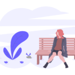 ベンチに佇む女性
